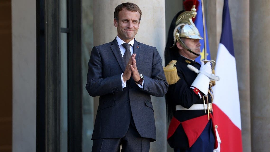 French President Emmanuel Macron gestures after a working lunch with Lebanese Prime Minister at the Elysee Palace, in Paris, on September 24, 2021. (AFP)