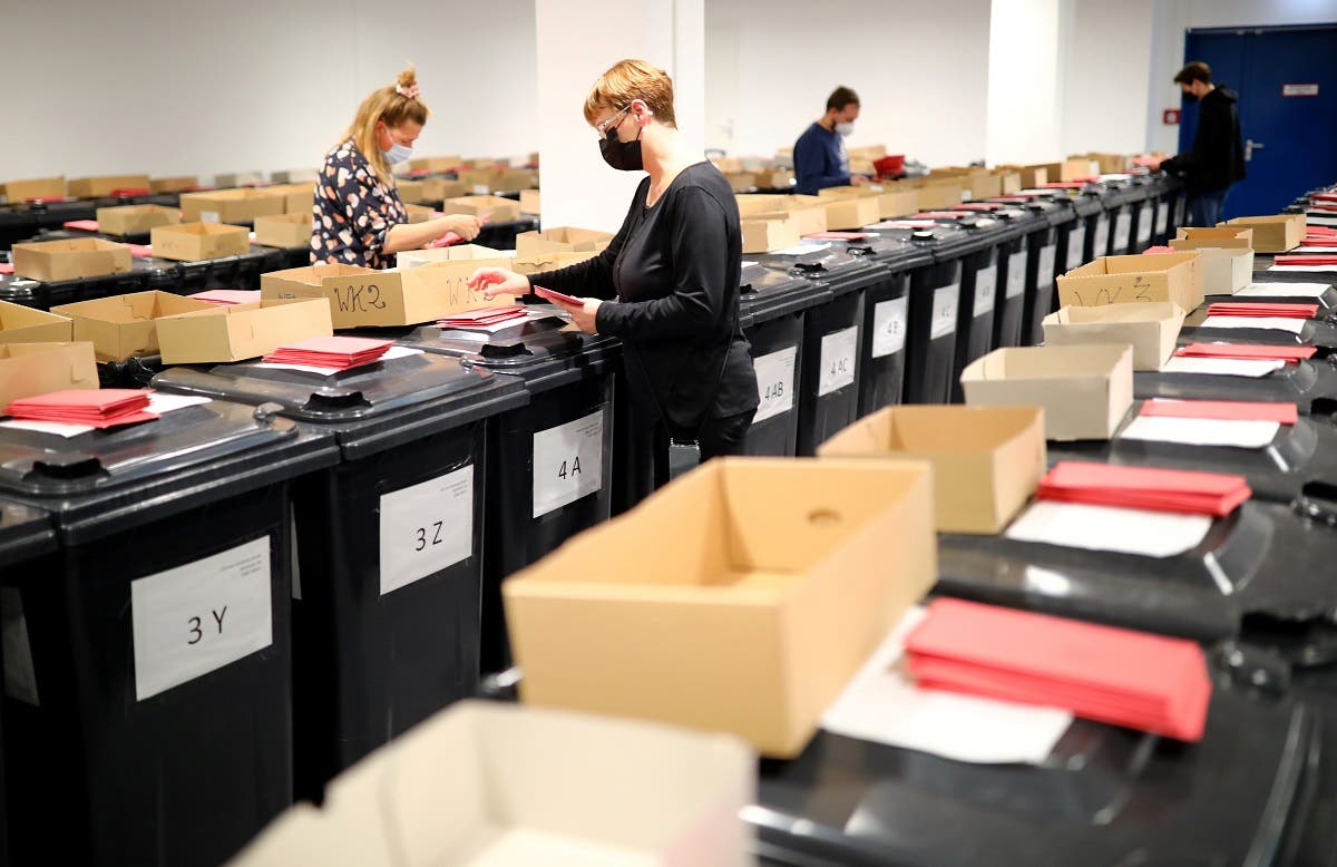 Envelopes of absentee ballots for the federal election are seen in Berlin, Germany, September 24, 2021. (Reuters)