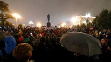 Russian police detain activists ahead of protest over online vote in recent polls