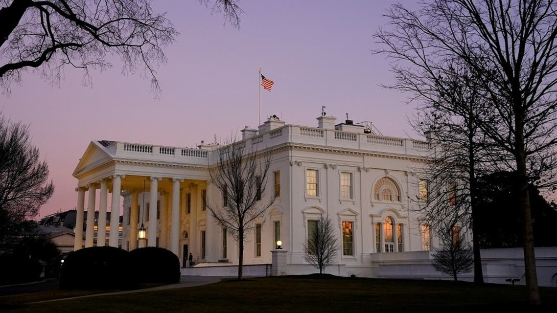 The White House is seen at sunset on US President Joe Biden's first day in office, Jan. 20, 2021. (Reuters)