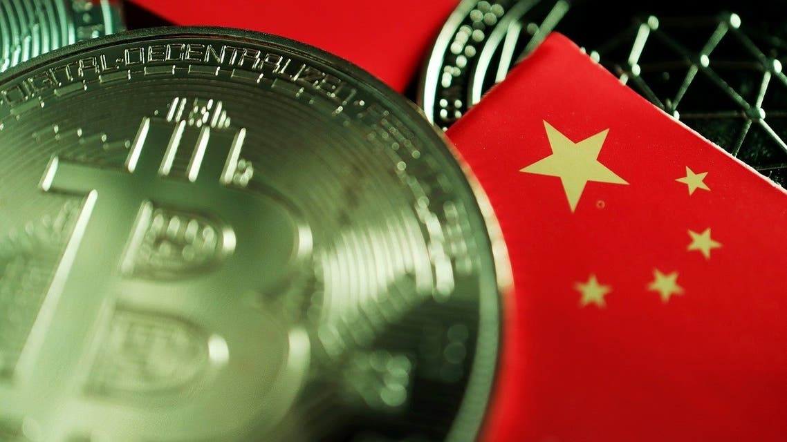 A Chinese flag is seen among representations of Bitcoin and other cryptocurrencies in this illustration picture. (Reuters)