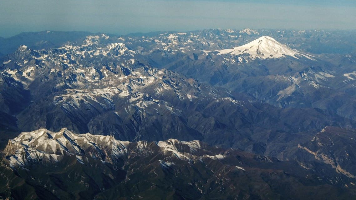 (FILES) This file photo taken on October 09, 2020, shows an aerial view of the Caucasus mountains in Russia with Mount Elbrus (5642 m) in the background. Five climbers died after a blizzard on Mount Elbrus, Europe's highest peak, Russia's emergencies ministry said on September 24, 2021. (File photo: AFP)