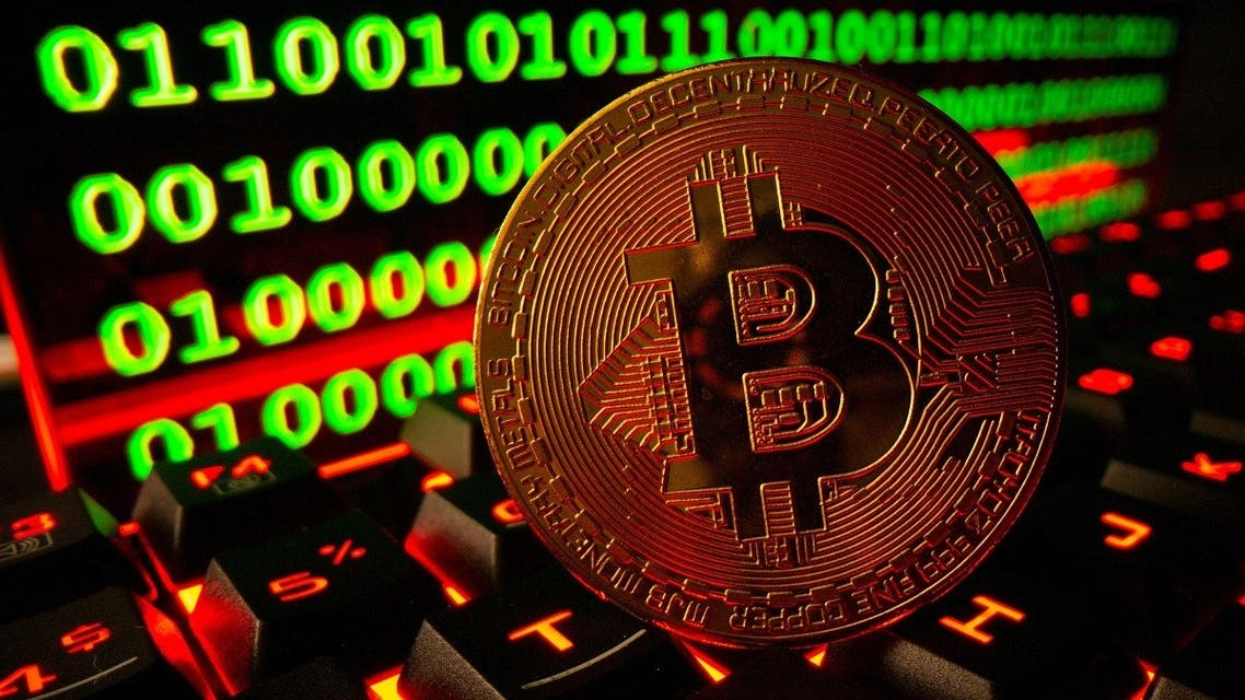 Bitcoin cryptocurrency representation is pictured on a keyboard in front of binary code in this illustration taken on September 24, 2021. (Reuters)