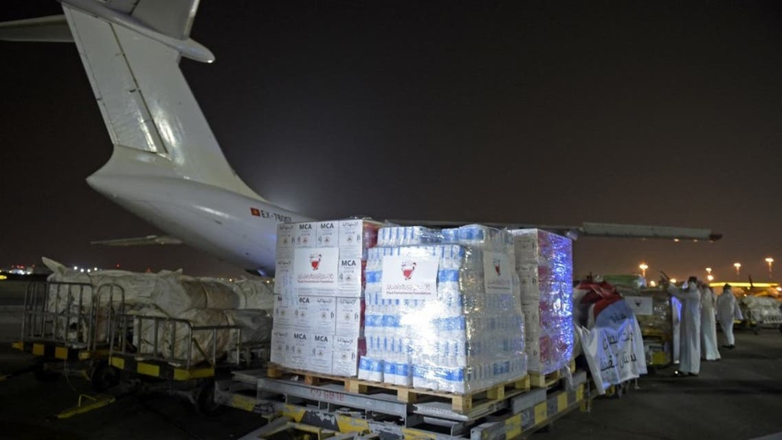 Workers and volunteers load a shipment of humanitarian aid to be sent to Afghanistan at Bahrain International Airport on Muharraq Island, near the capital Manama, on September 4, 2021. (AFP)