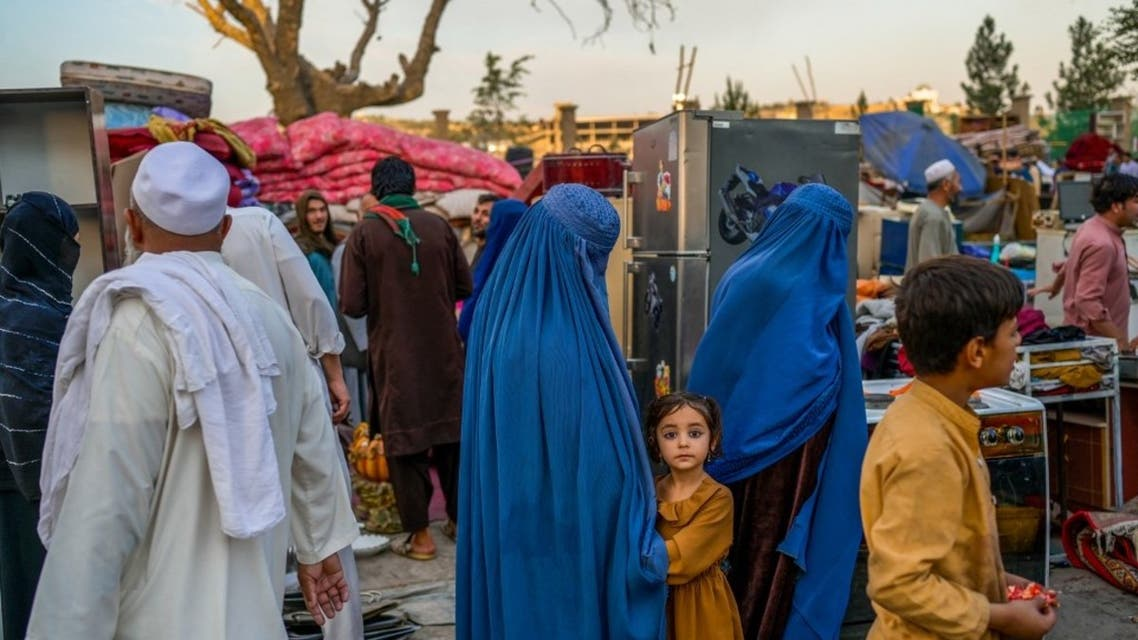 In this picture taken on September 22, 2021, people visit a stall selling secondhand items at a market in Kabul. (AFP)