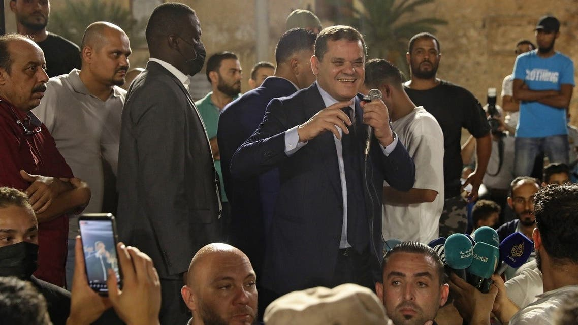 Libya's interim Prime Minister Abdulhamid Dbeibah greets a crowd in Tripoli's Martyrs' Square on September 21, 2021. (AFP)