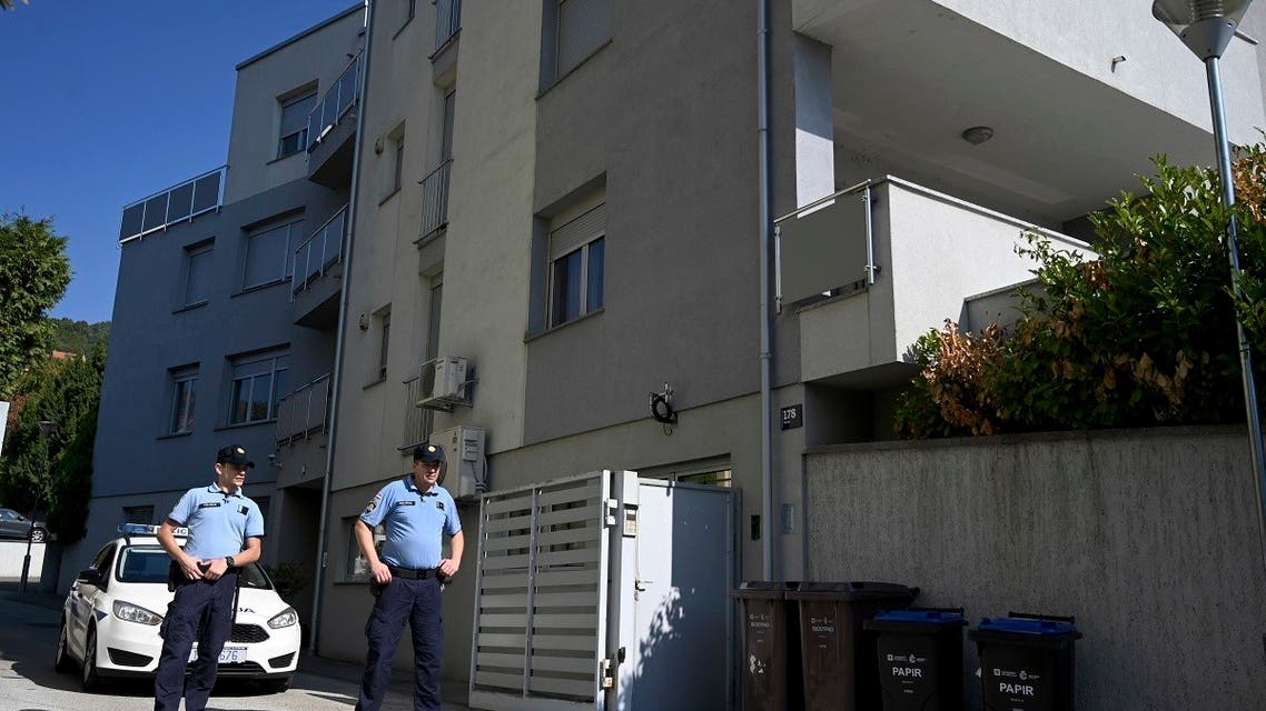 Police officers stand in front of an apartment building where a man allegedly killed his three children and attempted suicide afterwards, in Zagreb, Croatia. (AP)