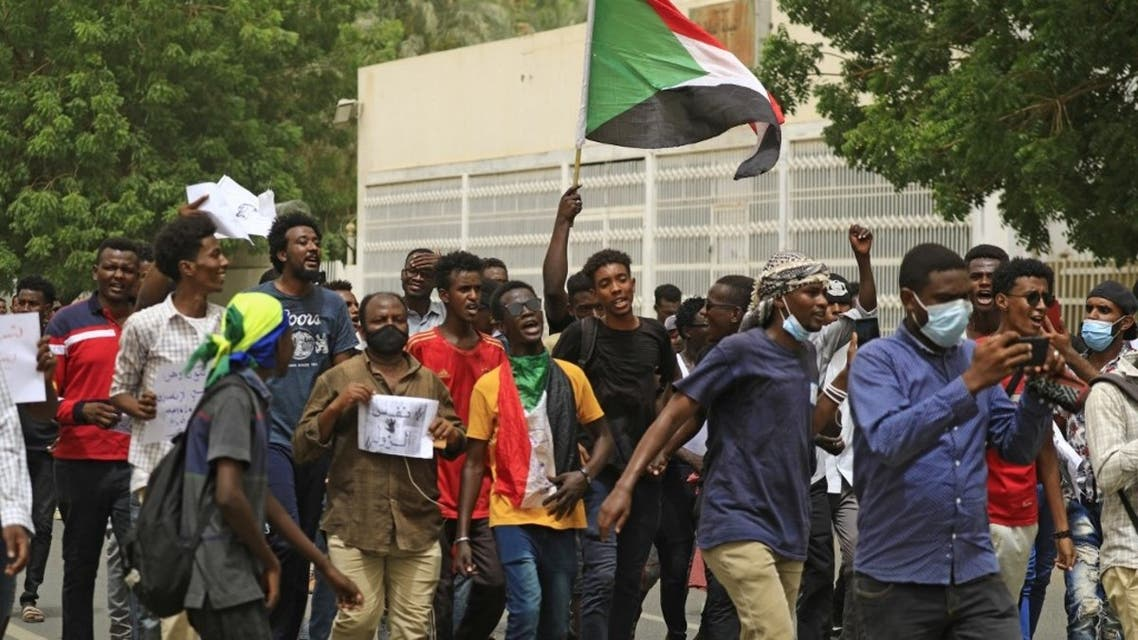 Sudanese protesters shout slogans and wave their country's national flag as they march in the capital Khartoum, on June 3, 2021. (AFP)
