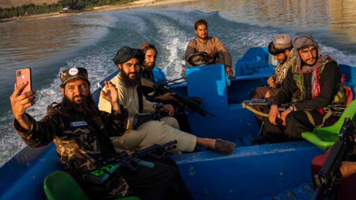 Taliban fighters enjoy a boat ride in the Qargha dam, outskirt of Kabul, Afghanistan, Friday, Sept. 24, 2021. (AP)(1)