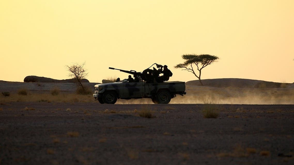 The Polisario Front soldiers drive a pick-up truck mounted with an anti-aircraft weapon during sunset in Bir Lahlou, Western Sahara, September 9, 2016. (Reuters/Zohra Bensemra)