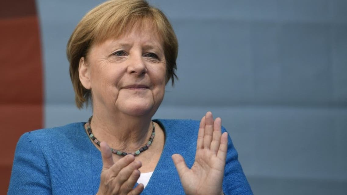 German Chancellor Angela Merkel applauds during a campaign rally for Christian Democratic Union CDU leader and chancellor candidate Armin Laschet (not pictured) in Aachen, western Germany, on September 25, 2021, one day ahead of the German federal elections. (AFP)