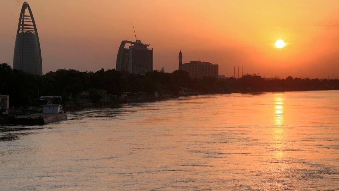 This picture taken on September 21, 2021 shows a view of the (L to R) landmark Greater Nile Petroleum Oil Company (GNPOC) Tower and PetroDar Operating Company (PDOC) Tower near the Blue Nile river waterfront in the north of Sudan's capital Khartoum at sunset. (AFP)