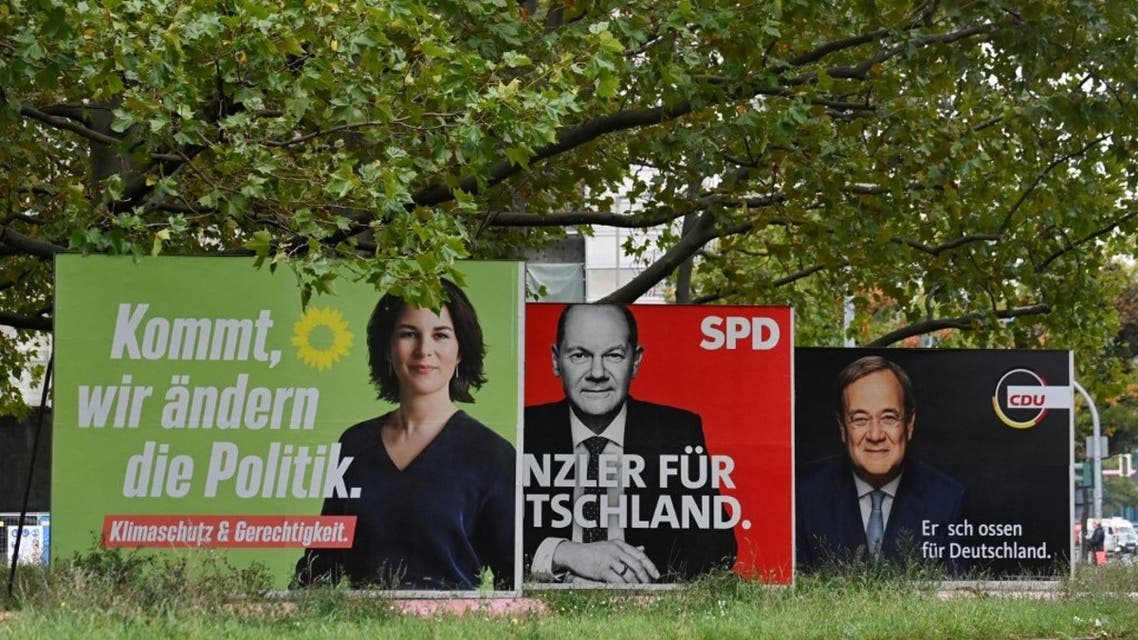 Billboards with election campaign posters showing the three chancellor candidates in the the September 26 federal election, (LtoR) co-leader of Germany's Greens (Die Gruenen) Annalena Baerbock, German Finance Minister and Vice-Chancellor of the Social Democratic SPD Party Olaf Scholz and Christian Democratic Union CDU leader Armin Laschet are seen in Berlin on September 25, 2021. (AFP)