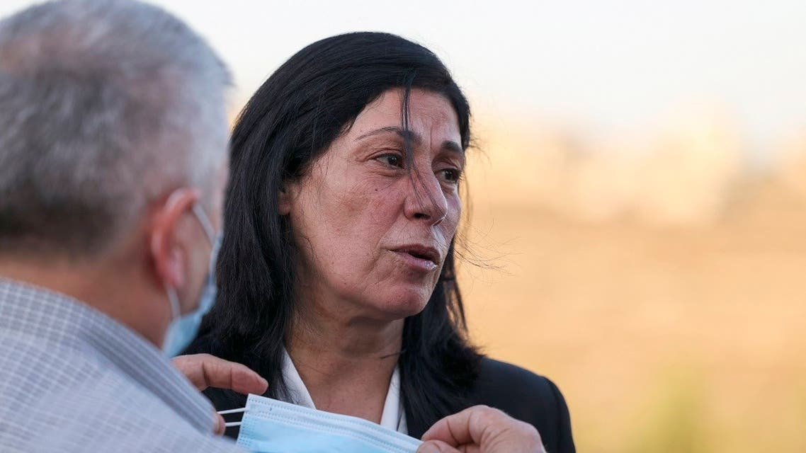 Palestinians welcome lawmaker Khalida Jarrar in Ramallah city in the occupied West Bank, on September 26, 2021, following her release from an Israeli prison. (AFP)