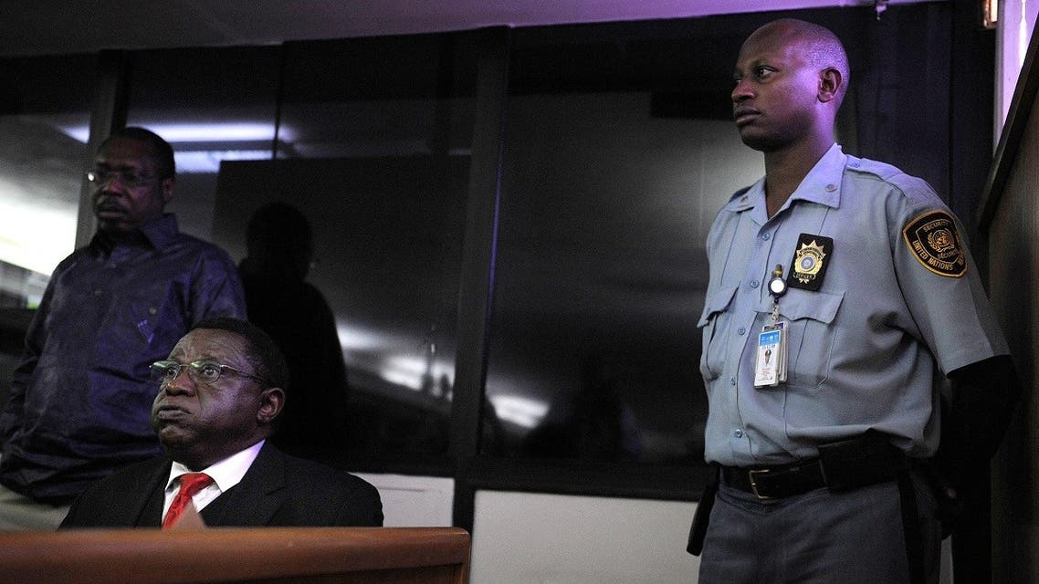 Former Rwanda army's Colonel Theoneste Bagosora (L) reacts in court as he awaits on December 18, 2008 the handing down of the verdict on charges of genocide. (AFP)
