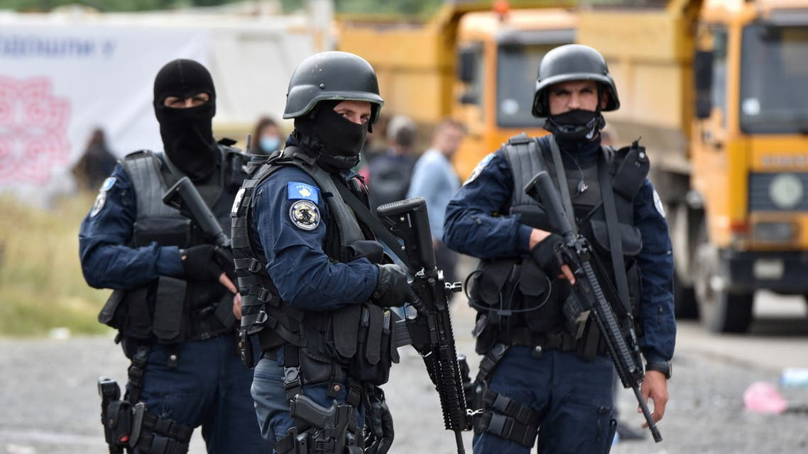 Kosovo special police officers are pictured as hundreds of Kosovo Serbs protest against a government ban on entry of vehicles with Serbian registration plates in Jarinje, Kosovo, September 21, 2021. (Reuters)