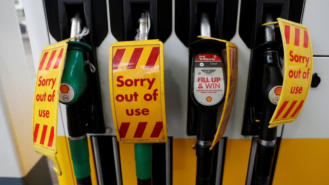 Out of use signs are seen on fuel pumps at a filling station that has run out of fuel, in London, Britain, September 25, 2021. REUTERS/Peter Nicholls