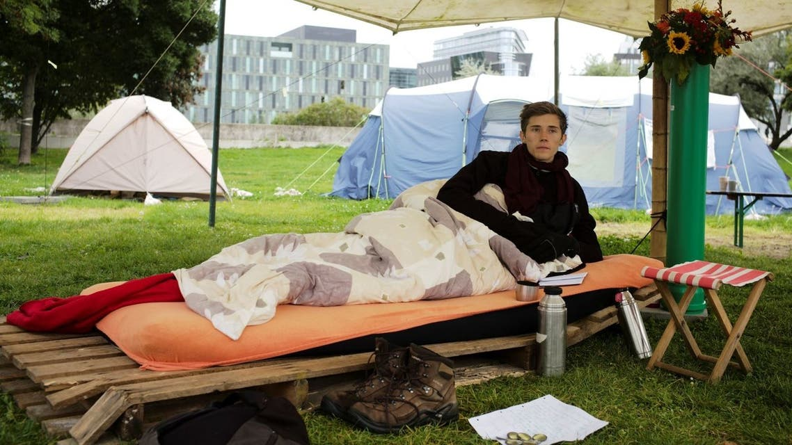 Climate activist Henning Jeschke, lays on a mattress under a tent in a small camp of climate activists as he poses for a photo in Berlin, Wednesday, Sept. 22, 2021. (AP)