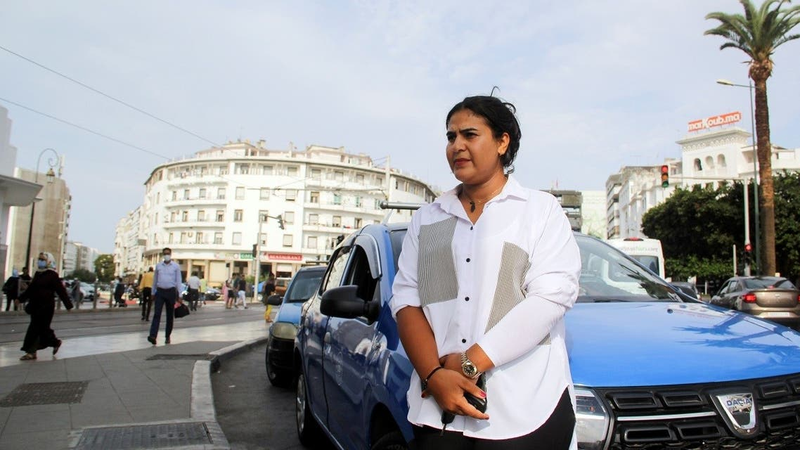 Female taxi driver Souad Hdidou, 33, stands near her taxi as she waits for passengers in Rabat, Morocco September 23, 2021. (Reuters)