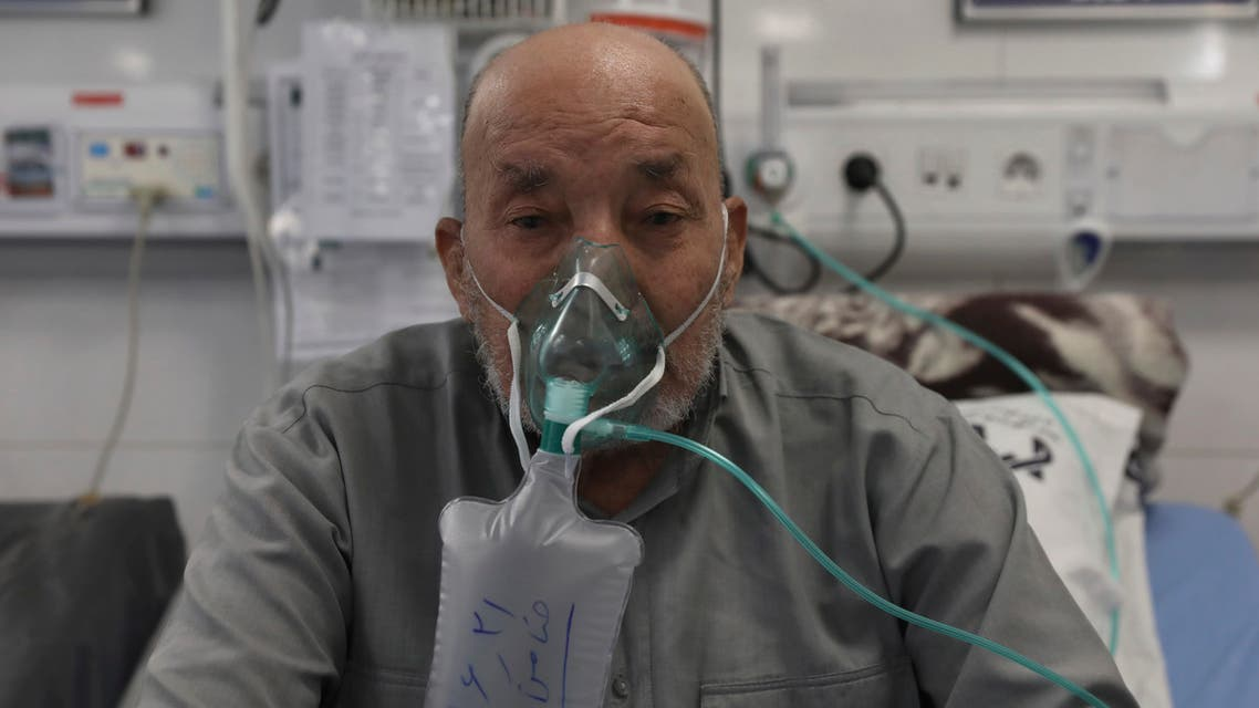 Afghan citizen Zamen Mousavi, a Covid-19 patient breathes with oxygen mask at the COVID-19 ICU ward of Amir Al-Momenin hospital in the city of Qom, some 80 miles (125 kilometers) south of the capital Tehran, Iran, Wednesday, Sept. 15, 2021. (AP)