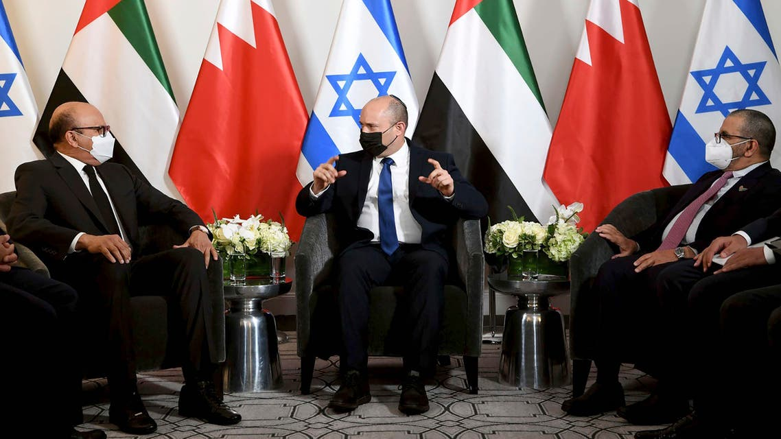 In this photo provided by Israel's Government Press Office, Israel's Prime Minister Naftali Bennett, center, meets with officials from the United Arab Emirates and Bahrain to celebrate the first anniversary of relations with the two Arab countries at a New York hotel on Sunday evening, Sept. 26, 2021. Bennett will address the U.N. General Assembly on Monday. (AP)
