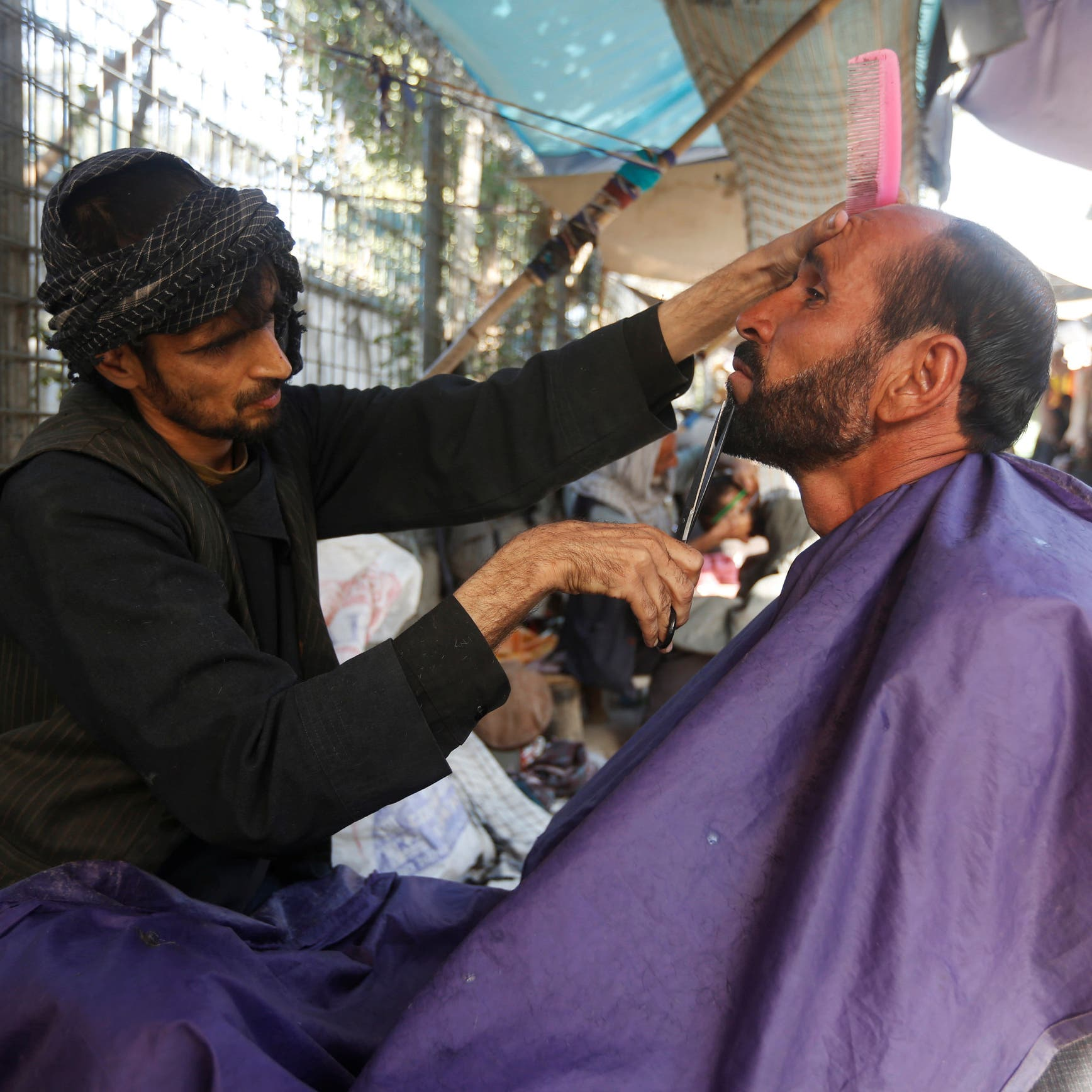 Forbidden business: Taliban prohibit barbers from shaving, trimming beards