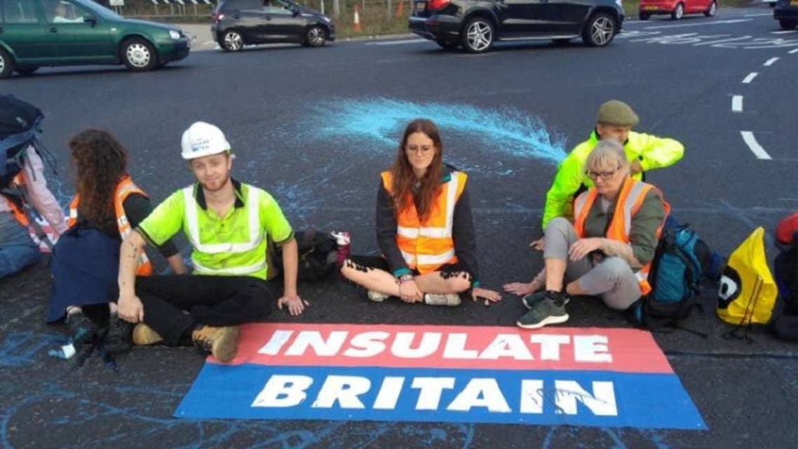 Members of Insulate Britain, demanding that the British government helps provide insulation for 29 million homes, block part of the M25 motorway near London, Britain, on September 20, 2021. (Reuters)