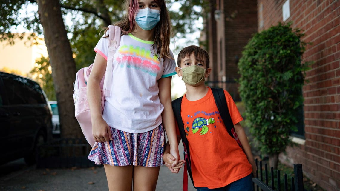 Special needs children Gianna Tesoriero, 11 and Roberto Tesoriero, 7, pose for a portrait in Brooklyn, New York, U.S., September 20, 2021. Picture taken September 20, 2021. REUTERS/Hannah Beier