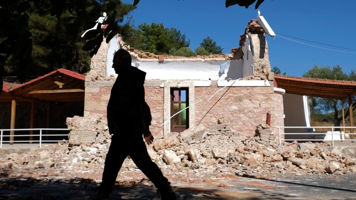 A resident passes next to a damaged Greek Orthodox chapel after a strong earthquake in Arcalochori village on the southern island of Crete, Greece, Monday, Sept. 27, 2021. (AP)