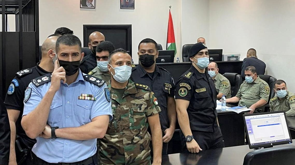 Palestinian security officers stand guard during a trial of security officers (not seen) over the death of Nizar Banat, a critic of President Mahmoud Abbas, in Ramallah in the Israeli-occupied West Bank September 14, 2021. (Reuters)