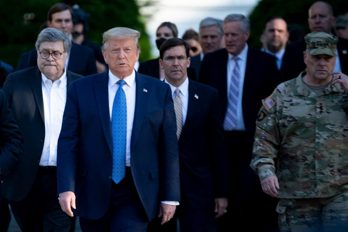 US President Donald Trump walks alongside Chairman of the Joint Chiefs of Staff Mark A. Milley (R), and others from the White House to visit St. John's Church, June 1, 2020. (AFP)
