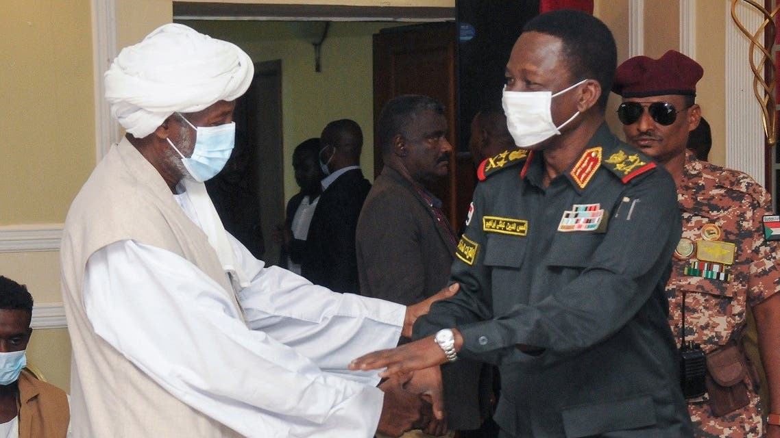 Member of Sudan's sovereign council Shams al-Din Kabashi (R) meets with head of the Supreme Council of Beja Prefectures and Independent Umudiyyahs Muhammad al-Amin Turk, upon arrival with a delegation to the city of Port Sudan, on September 26, 2021. (Ibrahim Ishaq/AFP)