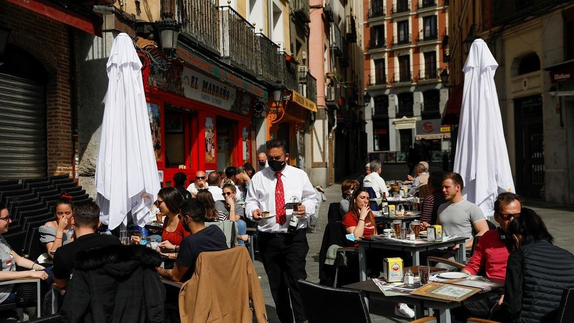 People have lunch at the terrace of a restaurant, amid the coronavirus disease (COVID-19) pandemic, in Madrid, Spain, March 22, 2021. (Reuters)