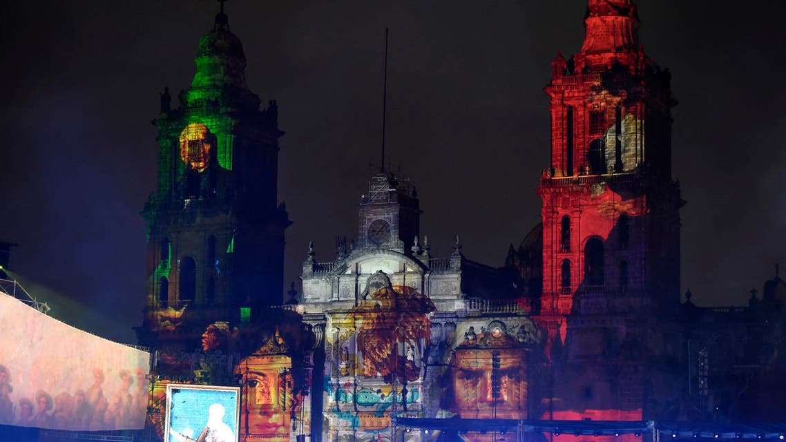 Portraits of Mexican heroes of the Independence are projected onto the Metropolitan Cathedral during the 200th Anniversary of the Consummation of Mexican Independence at the Zocalo square in Mexico City on September 27, 2021. (AFP)