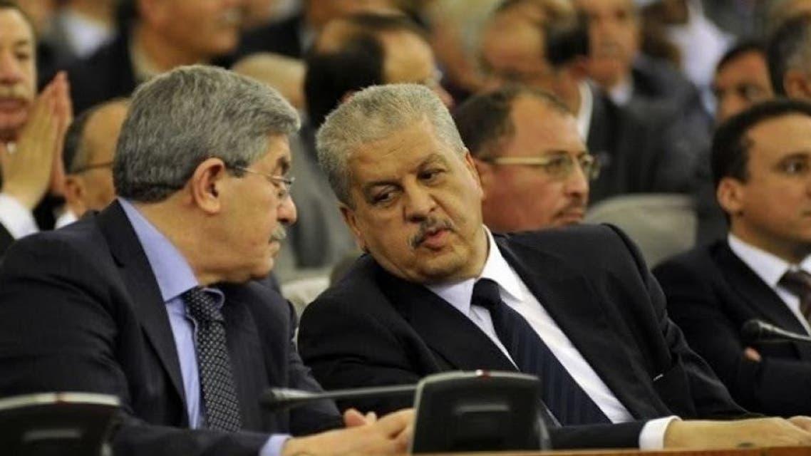 صورة لرئيسي الوزراء السابقين أحمد أيوحيى وعبد المالك سلال