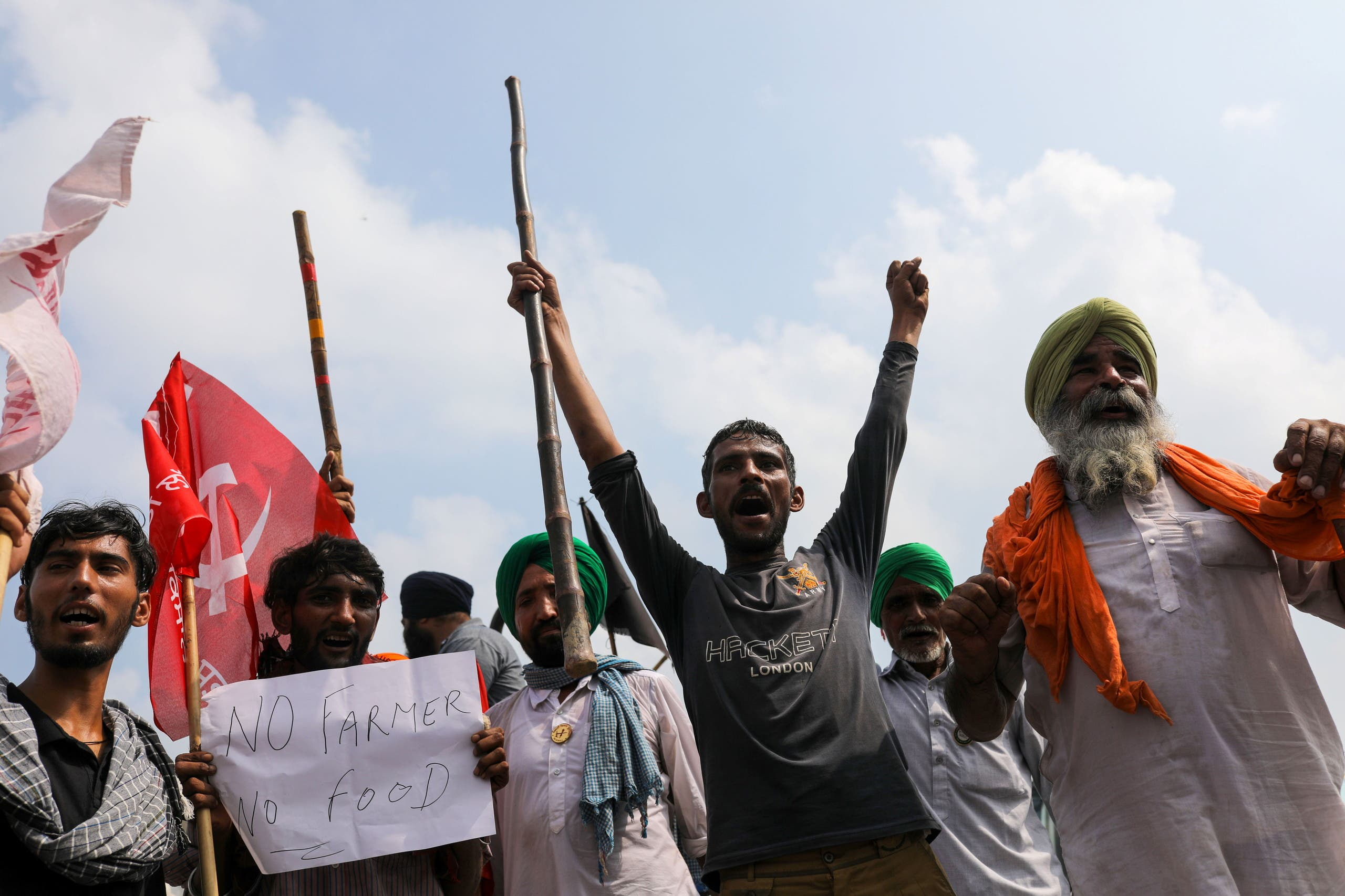 Farmers block railway tracks as part of protests against farm laws during nationwide protests, in Sonipat, northern state of Haryana, India, September 27, 2021. REUTERS/Anushree Fadnavi