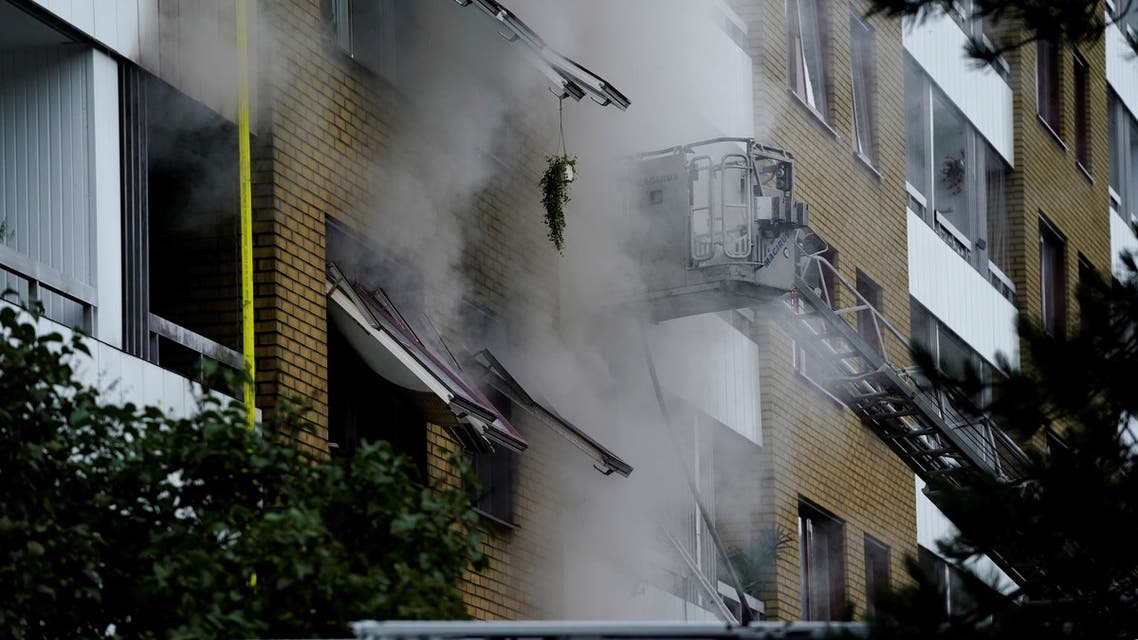 Smoke comes out of windows after an explosion hit an apartment building in Annedal, central Gothenburg, Sweden September 28, 2021. (Reuters)