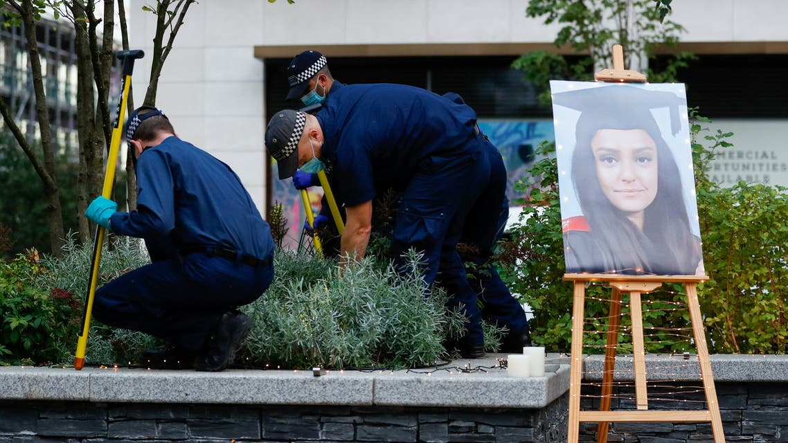 A portrait of Sabina Nessa, a teacher who was murdered in Pegler Square, is seen as police officers search the area prior to a vigil, in London, Britain September 24, 2021. (Reuters)
