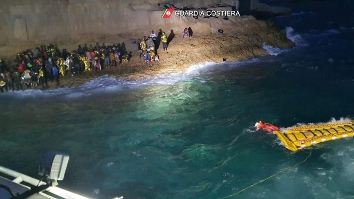 Italian coastguard members rescue 125 migrants who were found stranded on the shores of Isola dei Conigli, a small island close to Lampedusa, Italy, on September 9, 2021. (Reuters)