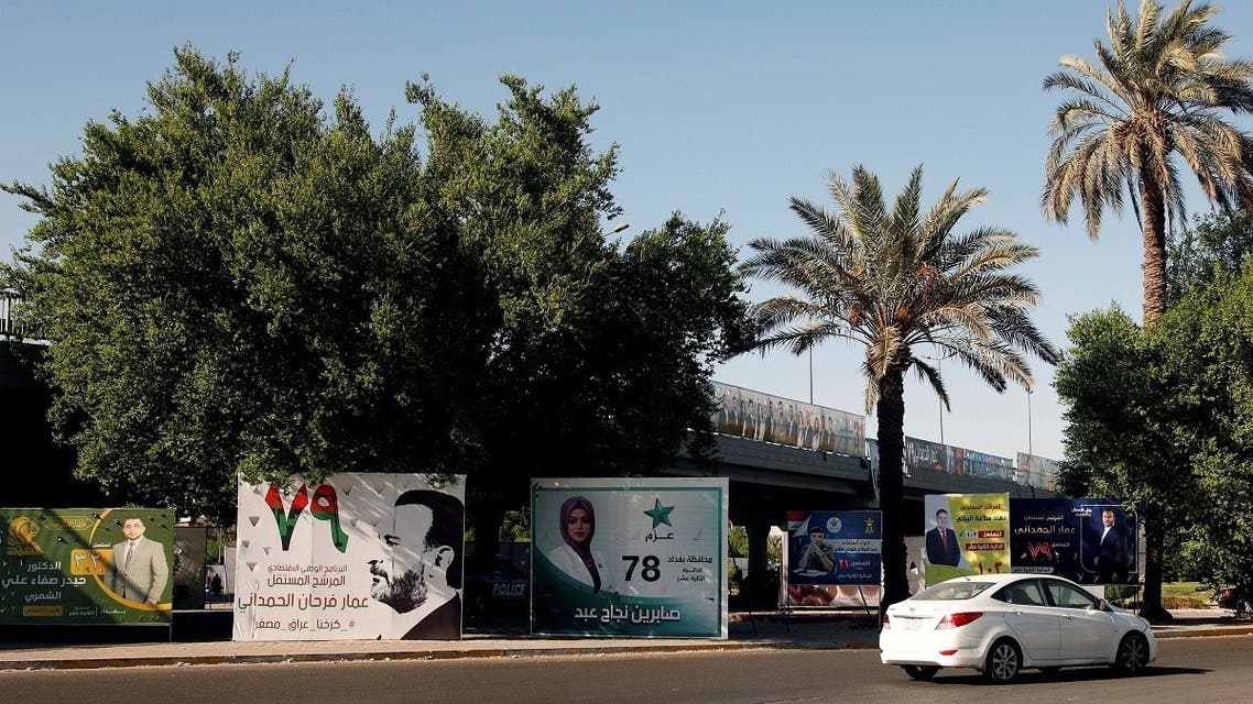 A car drives past election campaign posters ahead of the parliamentary election, in Baghdad, Iraq, on September 27, 2021. (Reuters)