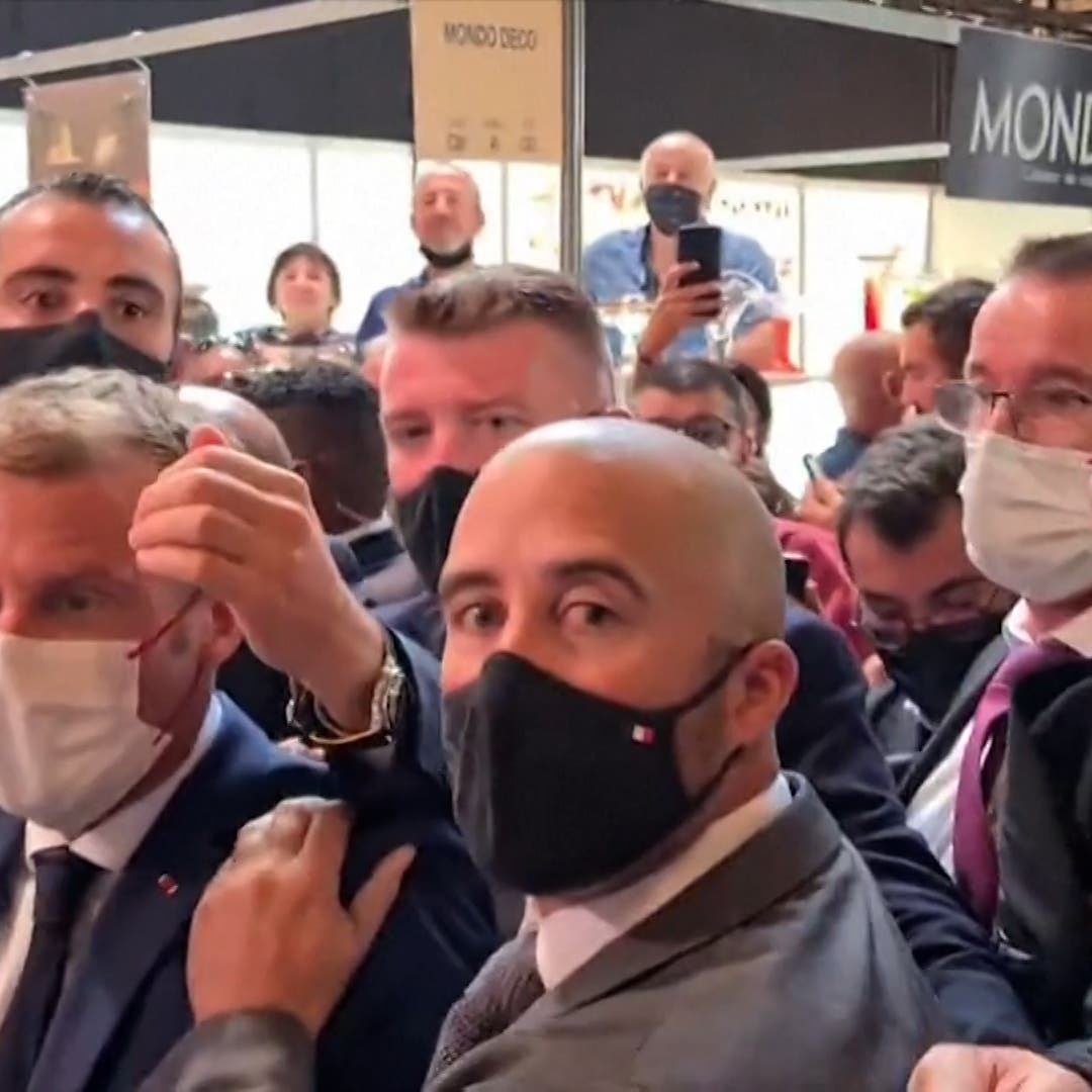 Watch: French President Macron hit with egg during restaurant fair visit