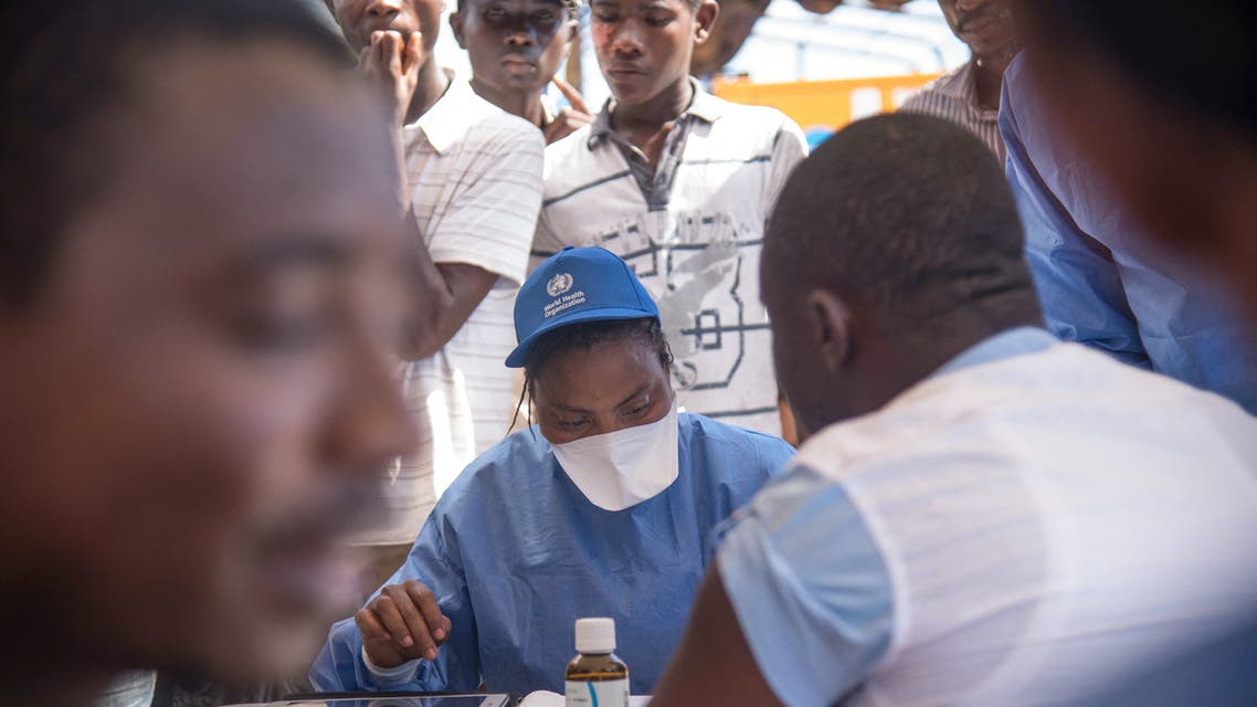 Nurses working with the World Health Organization (WHO) prepare to administer vaccines at the town all of Mbandaka on May 21, 2018 during the launch of the Ebola vaccination campaign. The death toll in an outbreak of Ebola in the Democratic Republic of Congo (DRC) rose to 26 on May 21, 2018, after a person died in the northwest city of Mbandaka, the government said, as it began vaccinating first responders against the dreaded disease.