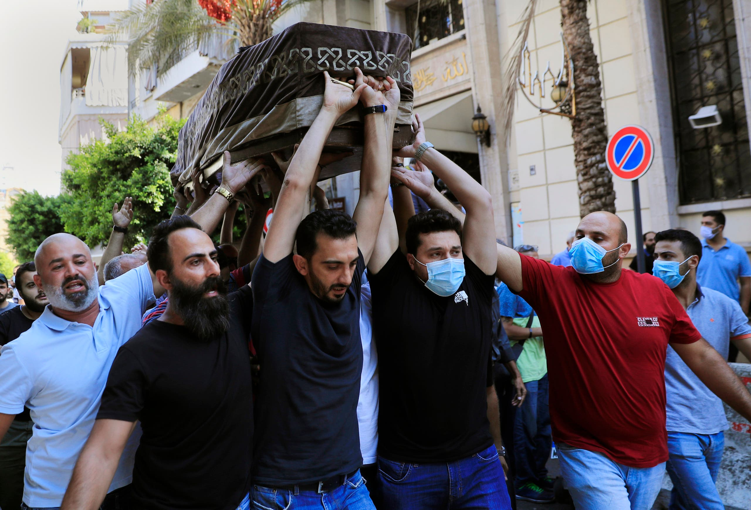 Mourners carry the coffin of Ibrahim Harb, 35, who was critically injured in the massive explosion at Beirut's port last year and who died on Monday nearly 14 months after the blast, in Beirut, Lebanon, Tuesday, Sept. 28, 2021.  (AP)