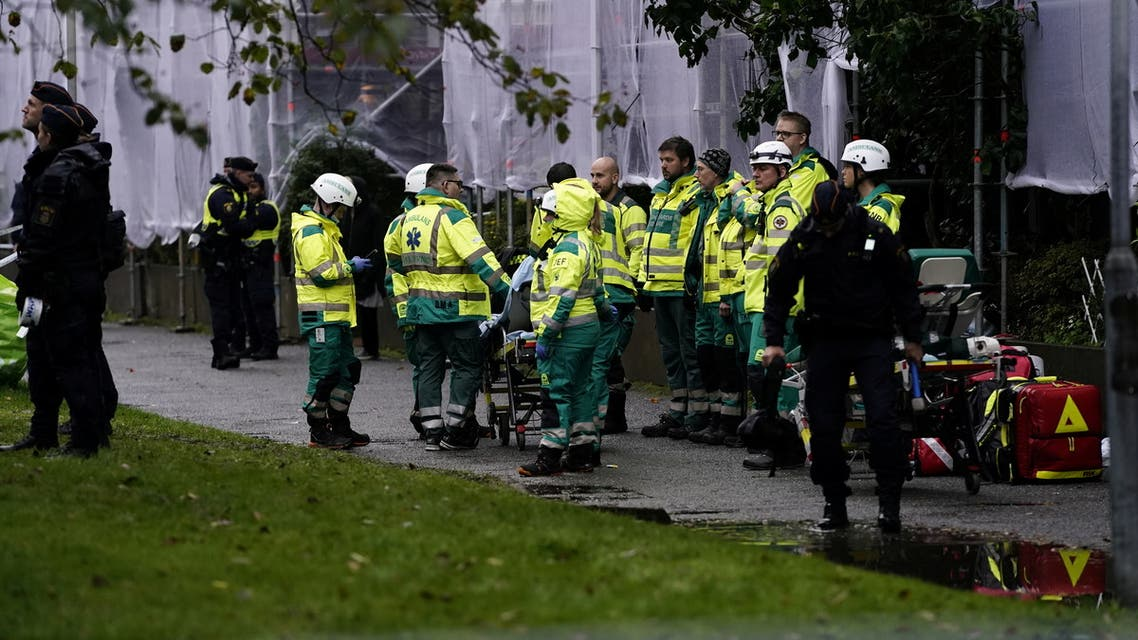 An emergency services crew works to evacuate people and put out fire after an explosion hit an apartment building in Annedal, central Gothenburg, Sweden September 28, 2021. (Reuters)