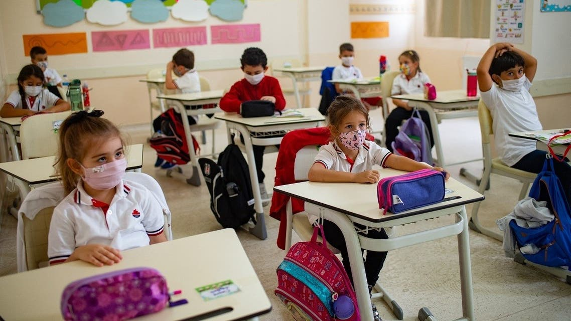 Pupils wearing face masks sit in a classroom amid the ongoing coronavirus pandemic at the Oguzkaan private school in Istanbul, on September 21, 2020. (AFP)