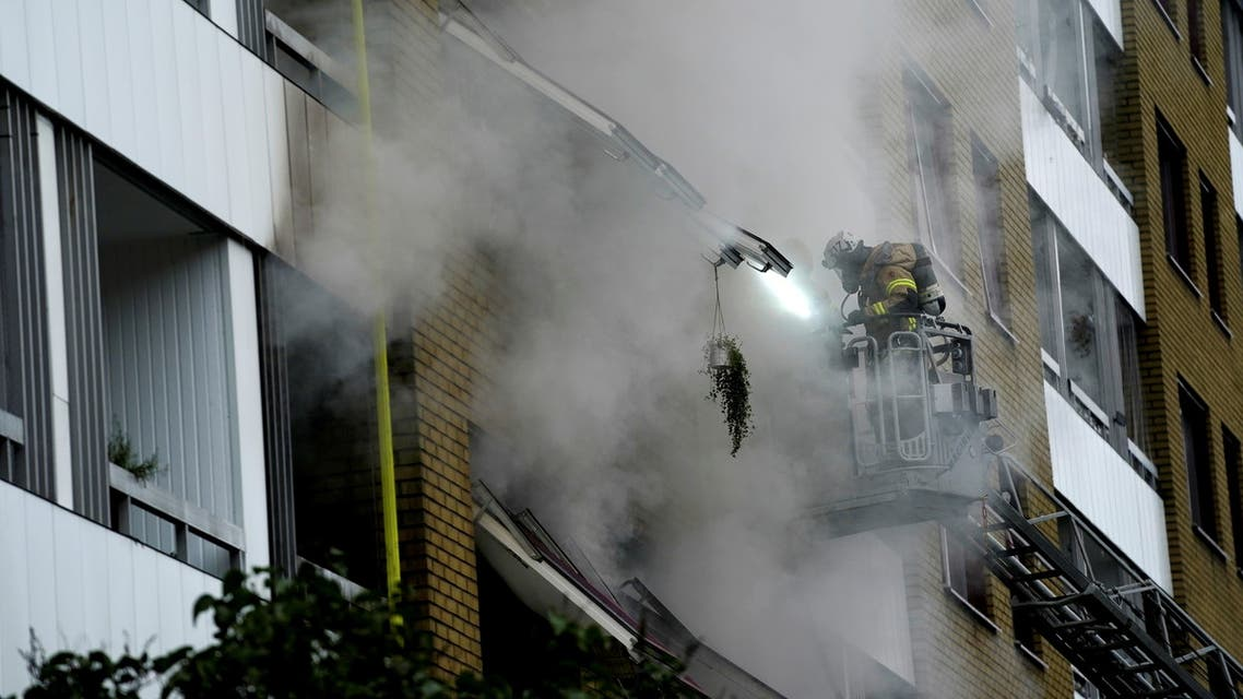 Smoke comes out of windows after an explosion hit an apartment building in Annedal, central Gothenburg, Sweden September 28, 2021. Larsson Rosvall / TT News Agency/via REUTERS ATTENTION EDITORS - THIS IMAGE WAS PROVIDED BY A THIRD PARTY. SWEDEN OUT. NO COMMERCIAL OR EDITORIAL SALES IN SWEDEN.