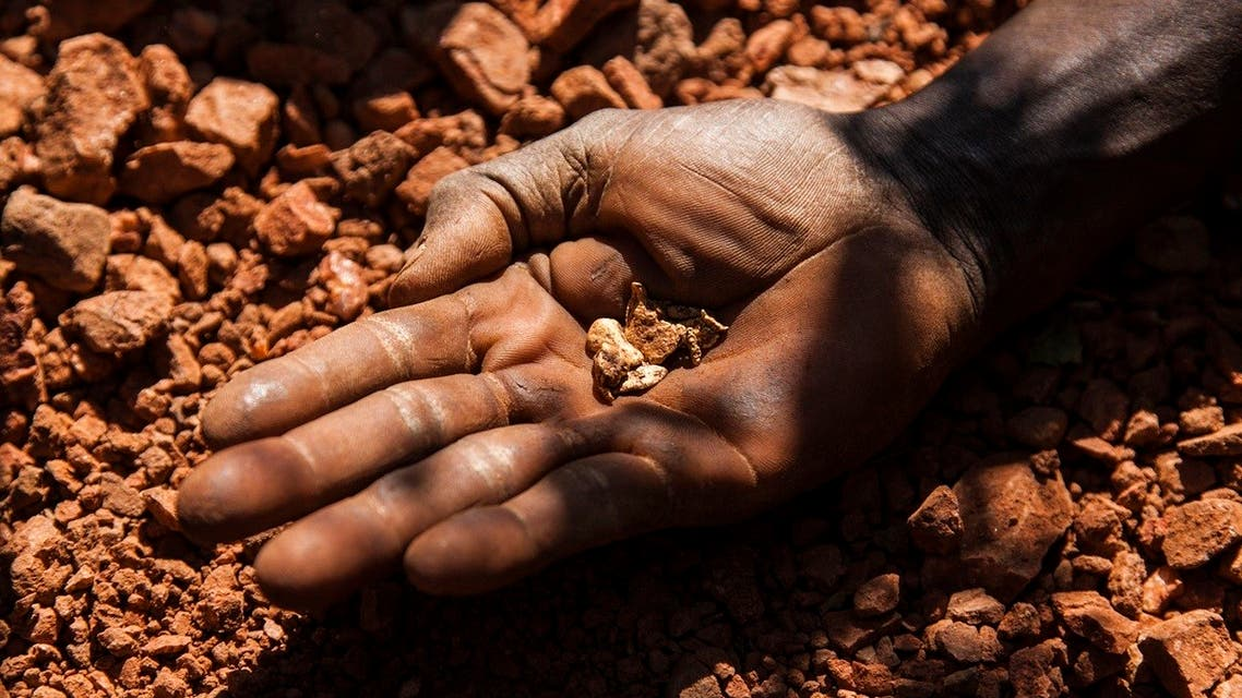 An artisan miner displays raw gold nuggets at an excavation site in Namorinyang, Eastern Equatoria, South Sudan. (File Photo: Reuters)