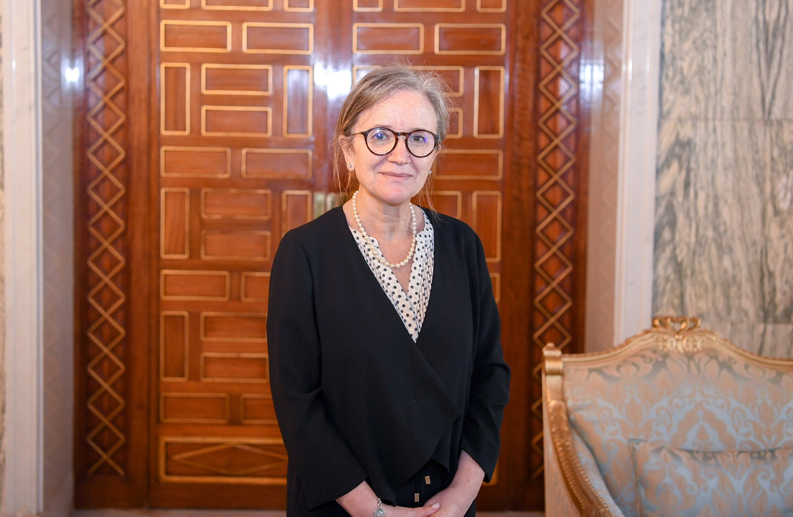 Newly appointed Prime Minister Najla Bouden Romdhane poses for a picture during her meeting with Tunisia's President Kais Saied, in Tunis, Tunisia September 29, 2021. (Reuters)