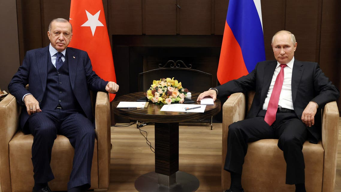 A handout picture taken and released on September 29, 2021 by the Turkish Presidential Press service shows Turkish President Recep Tayyip Erdogan (R) shaking hands with Russian President Vladimir Putin (L) ahead of their meeting in Sochi.