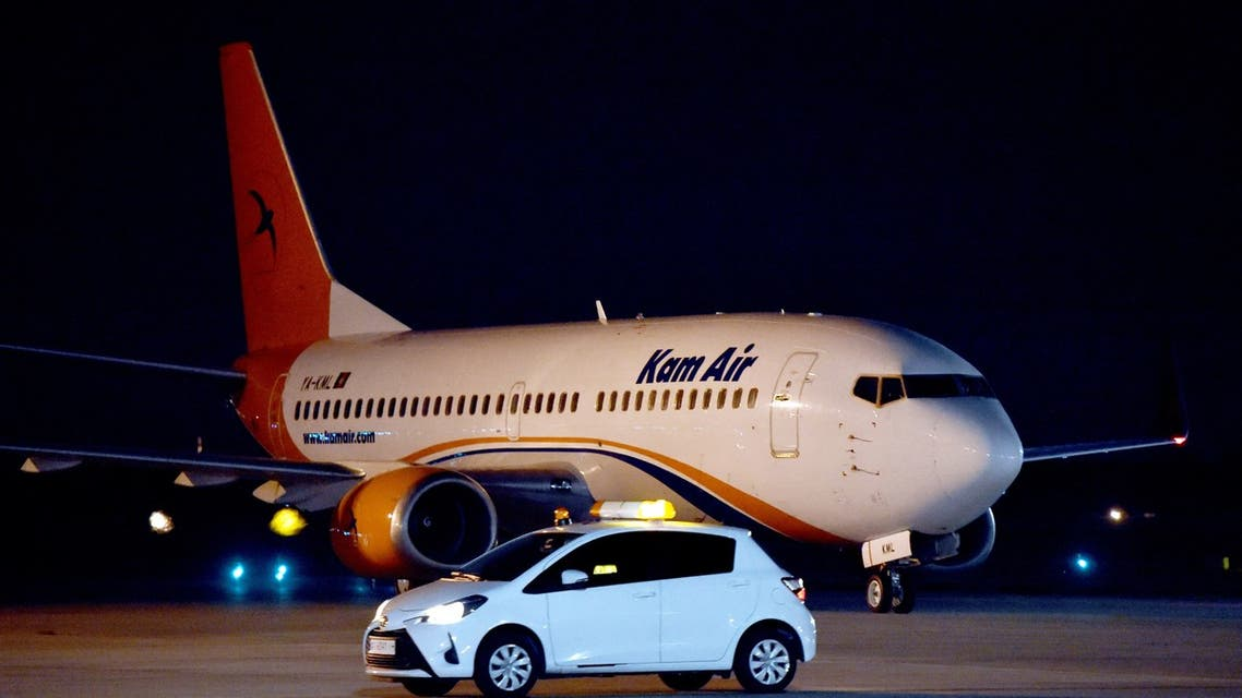 A Boeing 737-31S Kam Air passenger plane with people evacuated from Afghanistan on board, lands at Boryspil International Airport outside Kiev, on August 23, 2021.